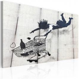 Obraz - Upadająca kobieta z wózkiem na zakupy (Banksy) (60x40 cm)